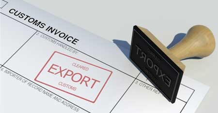 An export stamp lies on top of an invoice