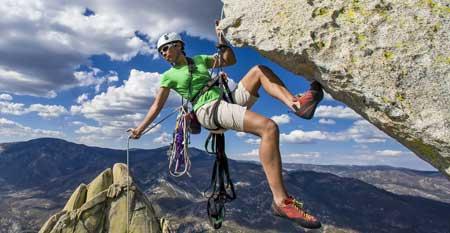 A free climber scales a mountain face