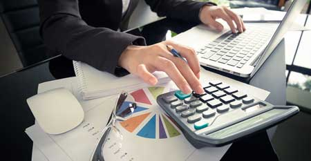 An accountant calculates a business's profit and loss.